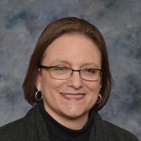 Dr. Carol Dionne